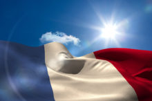 French national flag under sunny sky
