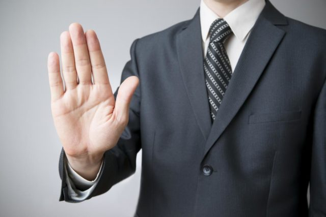 Businessman gesture with his hands on gray background
