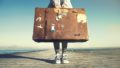 Young woman ready to travel with her suitcase