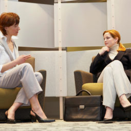 Two businesswomen sitting in office