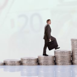 Businessman climbing money stairs