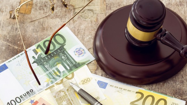 Law concept, gavel, clock and money on wooden table