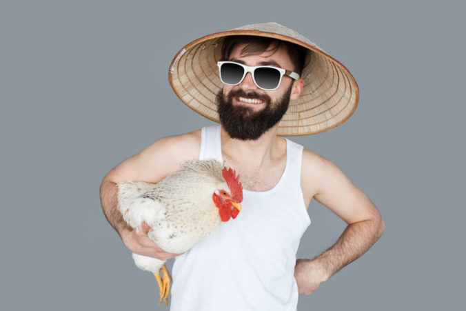 Crazy man holding a cock going to vacation