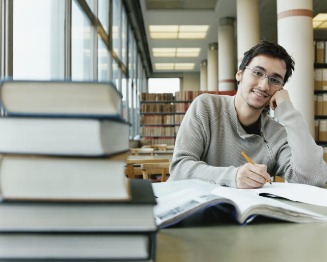 Portrait of a Student Studying in a Library