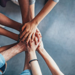 Stack of hands showing unity