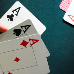 Man holding three aces, close up