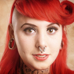 Girl with piercings and tattoos