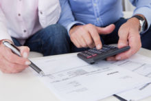 Close up of couple doing finances at home