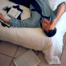 Businessman relaxing on bed