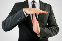 Businessman Showing Time Out Hand Sign