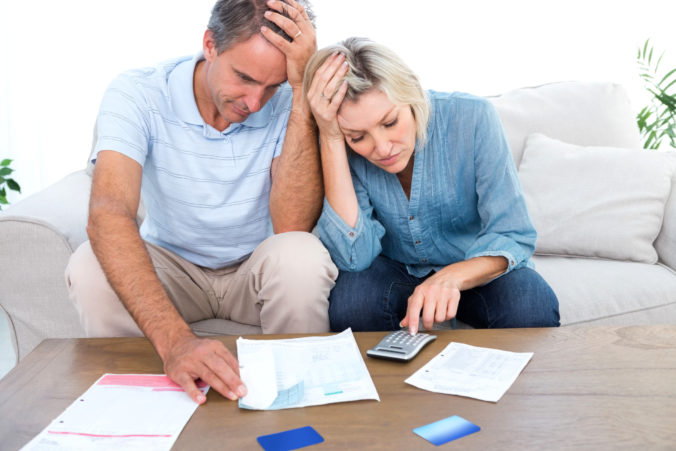 Worried couple going over finances