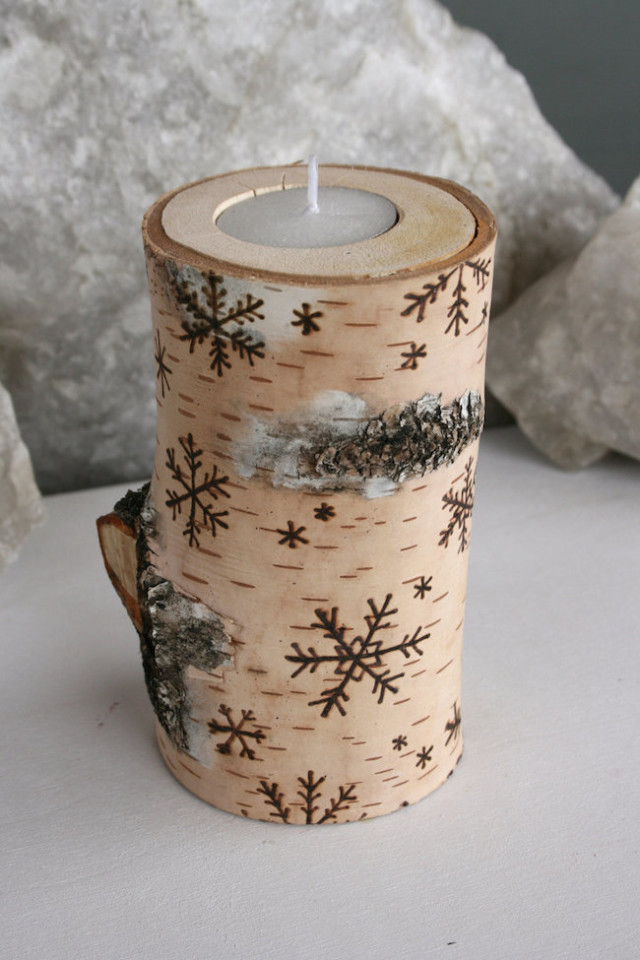 Birch wood candle holder with snowflake designs.jpg