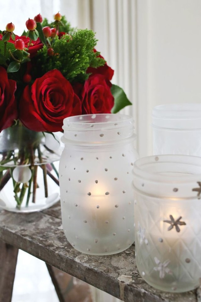 Frosted mason jar votives with snowflakes.jpg