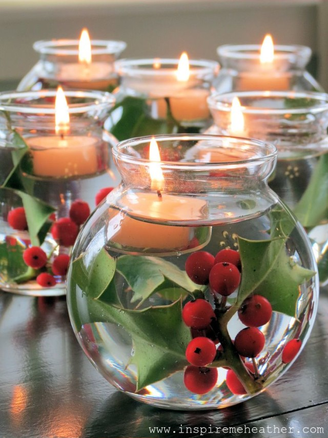 Glass bowls filled with water holly and floating candles.jpg