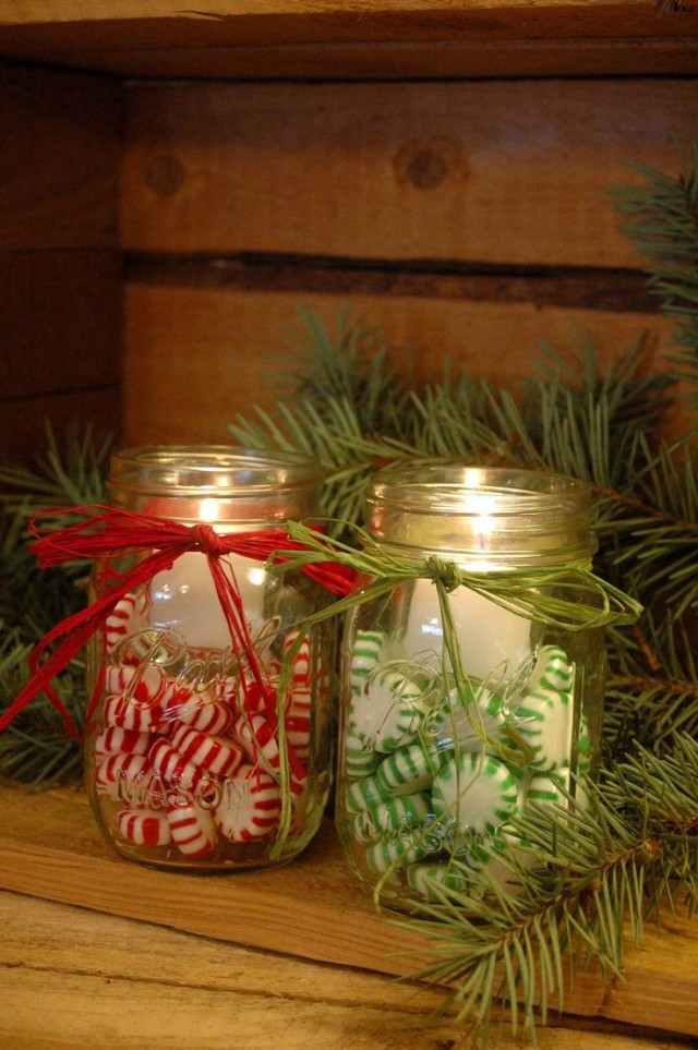Mason jars filled with christmas candies and candles.jpg