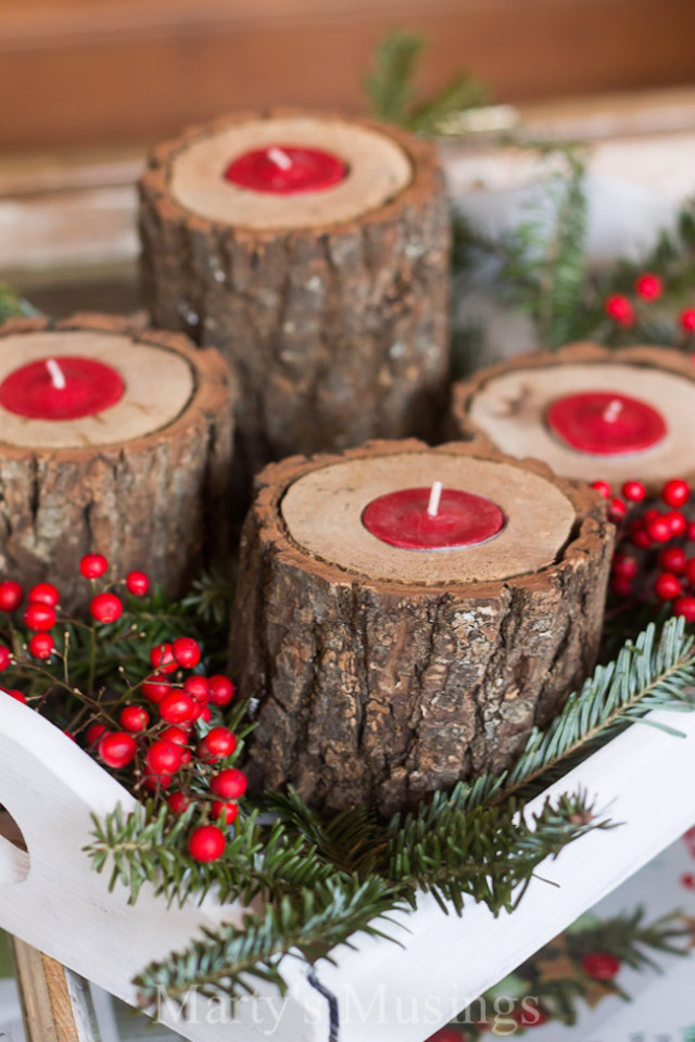 Rustic wood candle holders with red tea lights.jpg