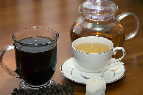 Cup of coffee with beans and cup of green tea with tea bag and pot horizontal_d87821cf 118e 4c0e af81 7a15865b0c2a prv.jpg