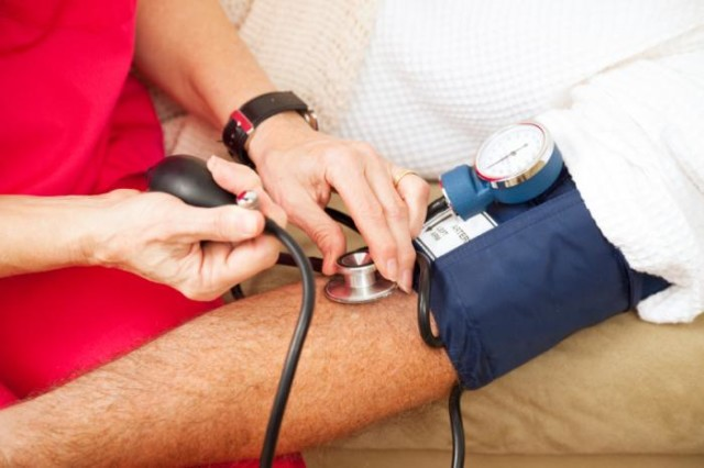 Man having blood pressure checked.jpg