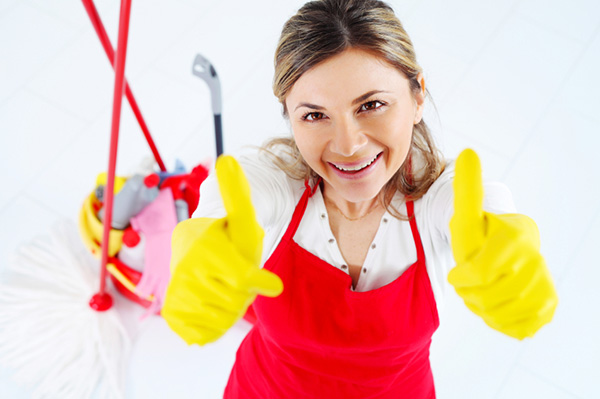 Woman cleaning giving thumbs up.jpg