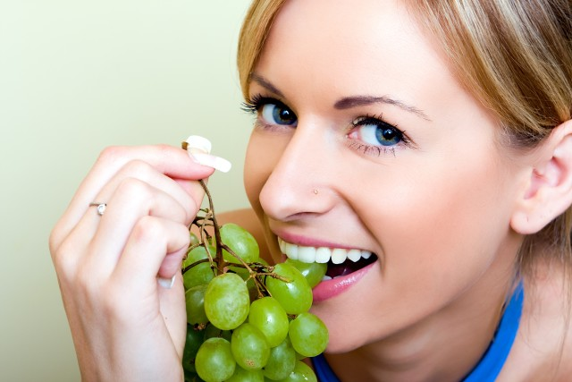 Beautiful woman with green grape
