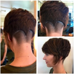 Stylish short haircut with long bangs.png