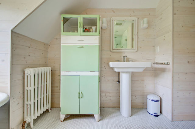 Post_bathroom cabinet vintage with farmhouse wood panel wall.jpg