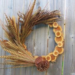 Pheasant feather and wood slice wreath.jpg