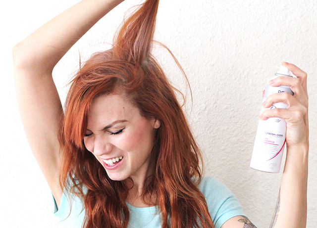 Woman using dry shampoo.jpg