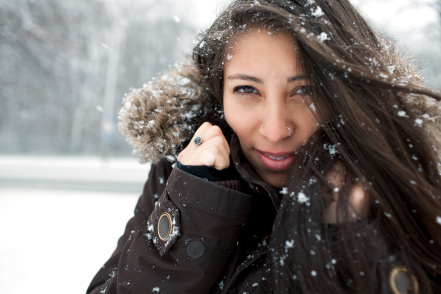 A beautiful woman on a winter snow