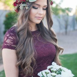 Bridesmaid wearing a burgundy lace dress and a jewel toned floral crown made out of dahlias and seeded eucalyptus via unfading beauty photography.jpg