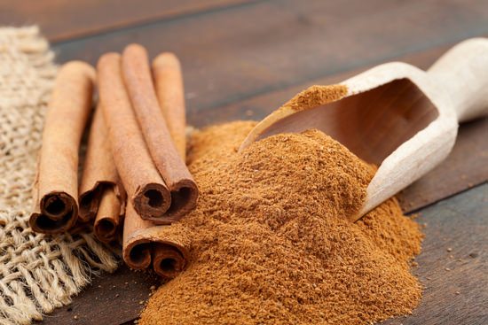 Cinnamon sticks and powder on wooden table.jpg