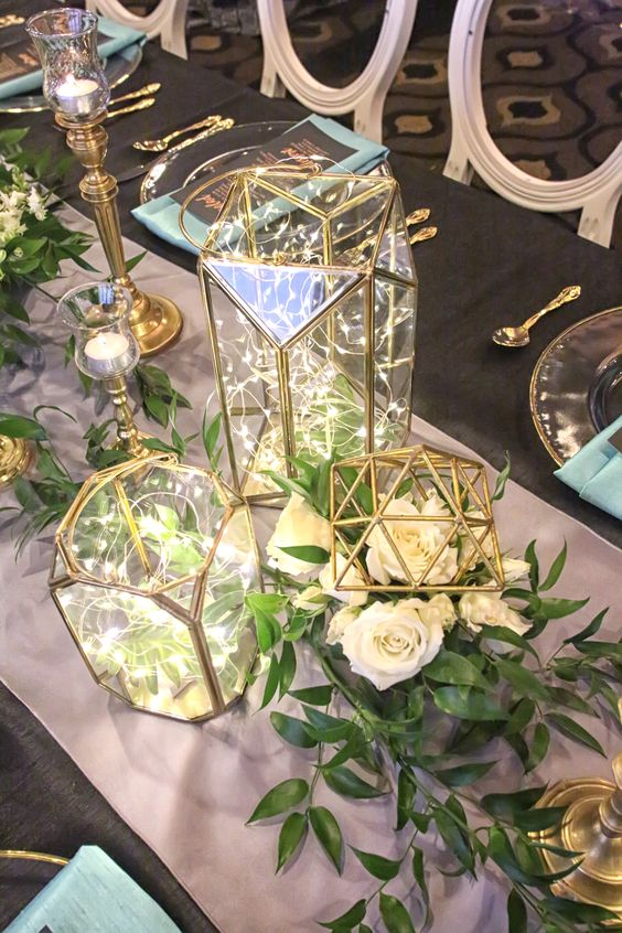Geometric figurines as armatures for the floral designs and geometric glass lanterns.jpg
