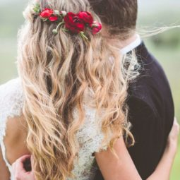 Half up half down wedding hairstyle with red flower crown.jpg