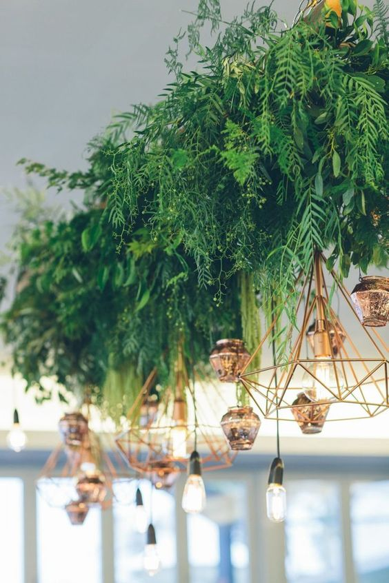 Hanging foliage and geometric lighting wedding decor.jpg