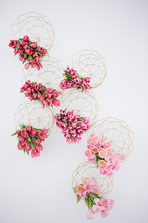 Shades of pink wedding inspiration with geometric designs as vessels bursting with tulips.jpg