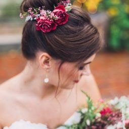 Top knot wedding updo hairstyle with red roses.jpg