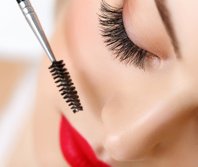 Eyelash mascara wand closeup red lips.jpg