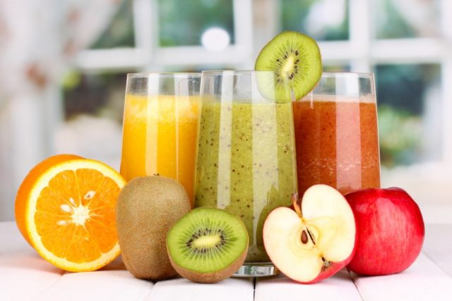 Bigstock fresh fruit juices on wooden t 54817562 840x560.jpg