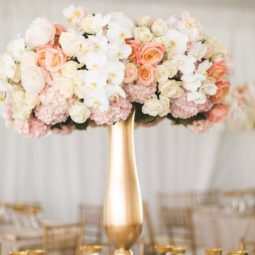 Blush and gold tall wedding centerpiece.jpg