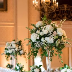 Greenery and white tall wedding centerpiece.jpg
