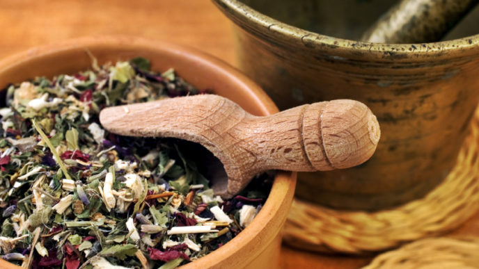 Mortar with bowl with herbs