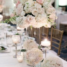 Roses hydrangeas and peonies tall wedding centerpiece.jpg