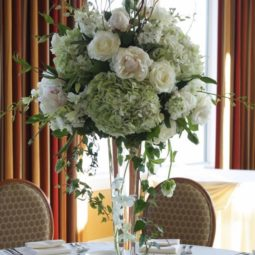 White and greenery tall wedding centerpiece.jpg