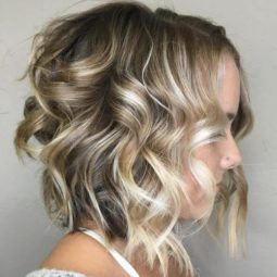 15 curly blonde balayage bob.jpg