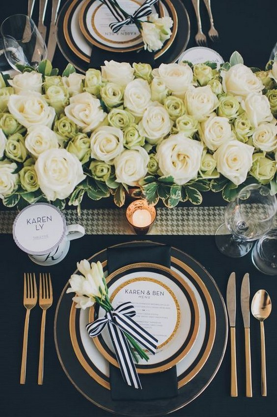 Black white and gold place setting for a wedding reception.jpg