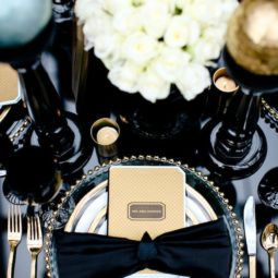 Black white and gold table setting.jpg