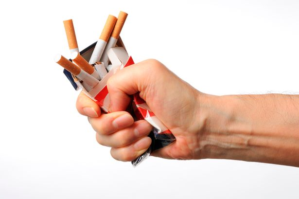 Isolated shot of broken cigarettes on white background.jpg