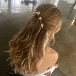 Half up hairstyle with floral hair pins 2018 wedding hair trends.jpg