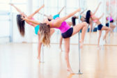 Group of women in a pole dance class looking sexy