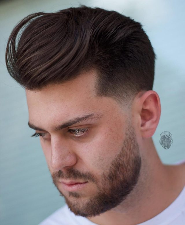 Travisanthonyhair taper haircut textured sweep back mens hair trends 2018 e1510267347294.jpg